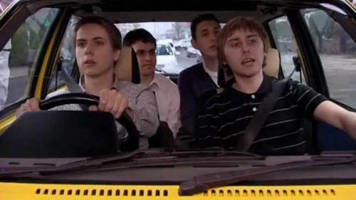 "Screenshot from ""The Inbetweeners"" where the four main characters are in the car."